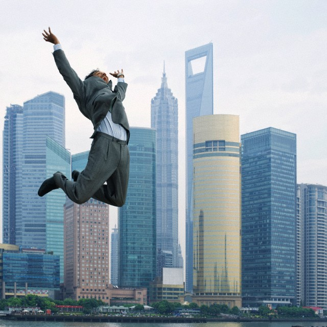 business man leaping in Shanghai, China